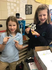 students showing off 3d printed objects